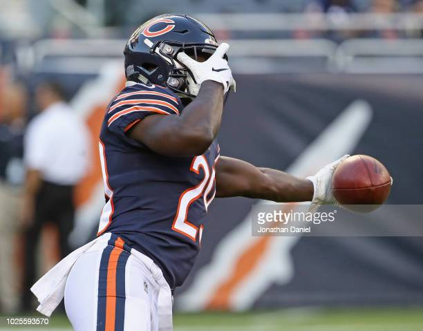 Tarik Cohen of the Chicago Bears covers his eyes as he plays onehanded catch during warmups before a preseason game against the Buffalo Bills at...