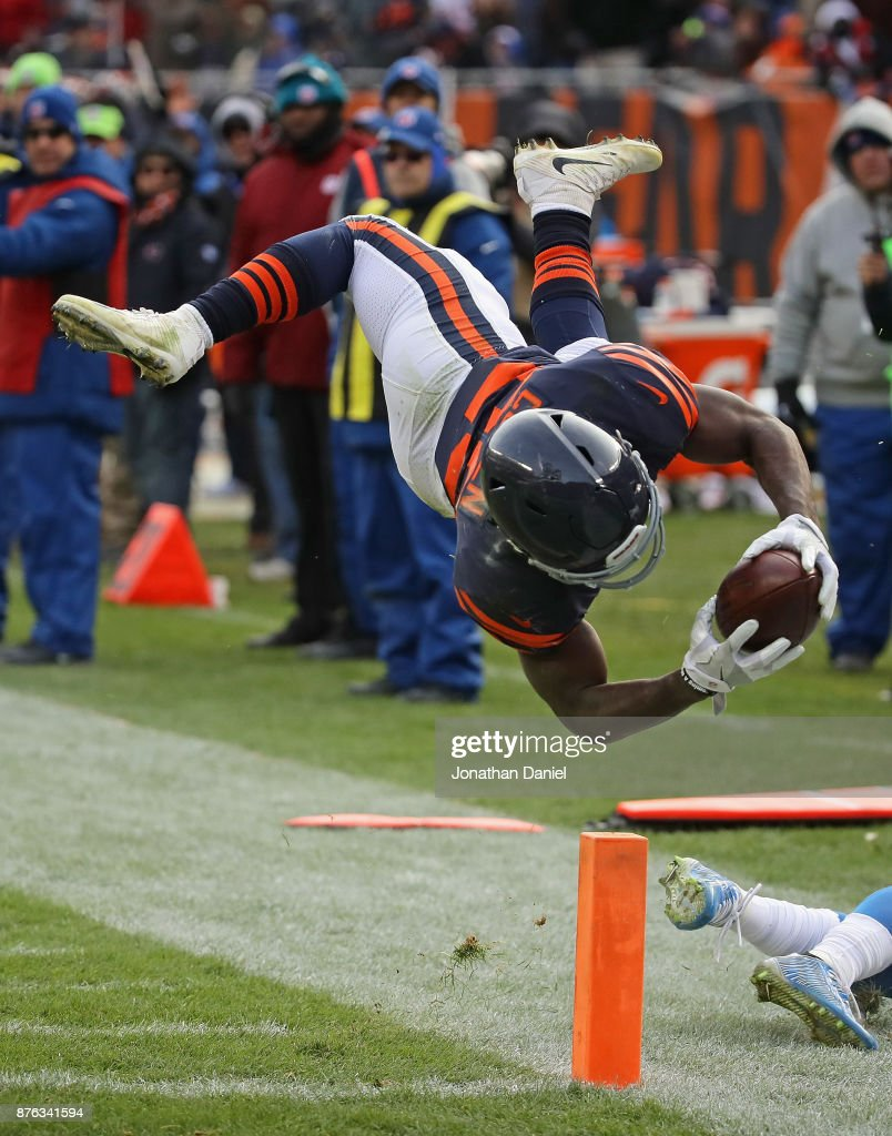 Tarik Cohen #29 of the Chicago Bears dives across the end zone to score a touchdown against the Detroit Lions at Soldier Field on November 19, 2017 in Chicago, Illinois. The Lions defeated the Bears 27-24.