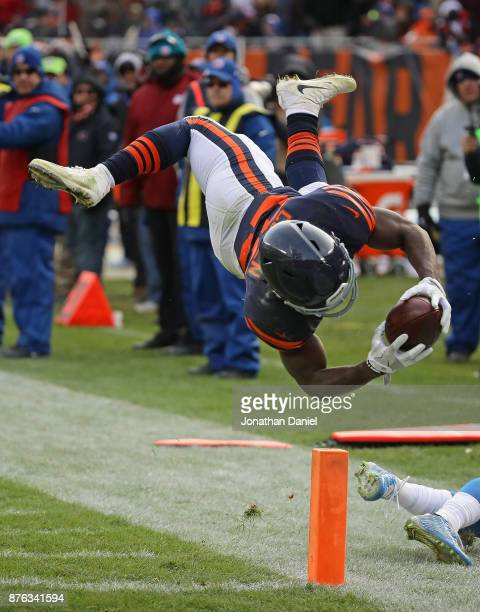 Tarik Cohen of the Chicago Bears dives across the end zone to score a touchdown against the Detroit Lions at Soldier Field on November 19 2017 in...