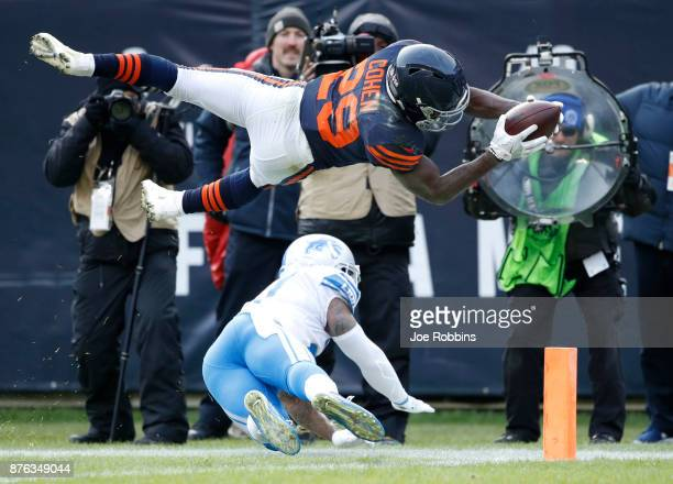 Tarik Cohen of the Chicago Bears dives into the endzone for a touchdown in the fourth quarter against the Detroit Lions at Soldier Field on November...