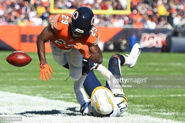 Tarik Cohen of the Chicago Bears is brought down by Jaylen Watkins of the Los Angeles Chargers during the first quarter of a game at Soldier Field on...