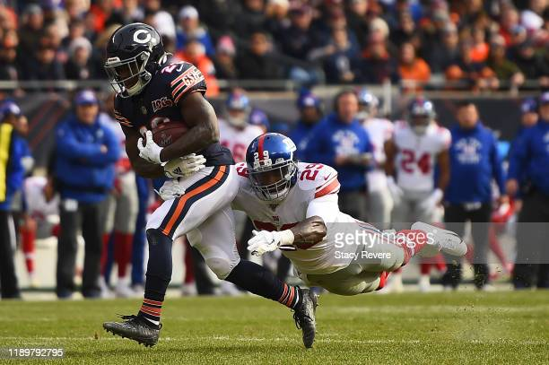 Tarik Cohen of the Chicago Bears is pursued by Deone Bucannon of the New York Giants during the first half at Soldier Field on November 24 2019 in...