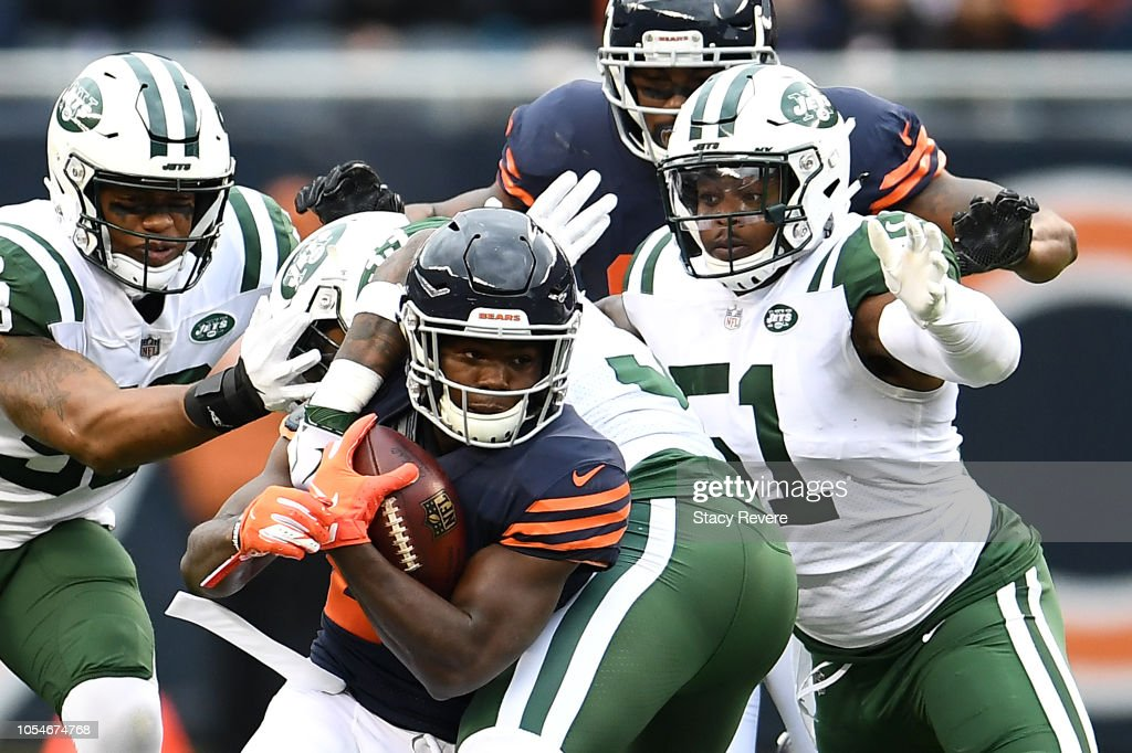 Tarik Cohen Of The Chicago Bears Is Tackled By Jamal Adams