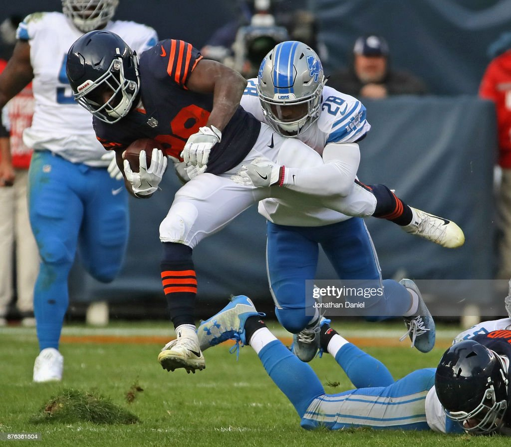 Tarik Cohen #29 of the Chicago Bears is tackled by Quandre Diggs #28 of the Detroit Lions at Soldier Field on November 19, 2017 in Chicago, Illinois. The Lions defeated the Bears 27-24.