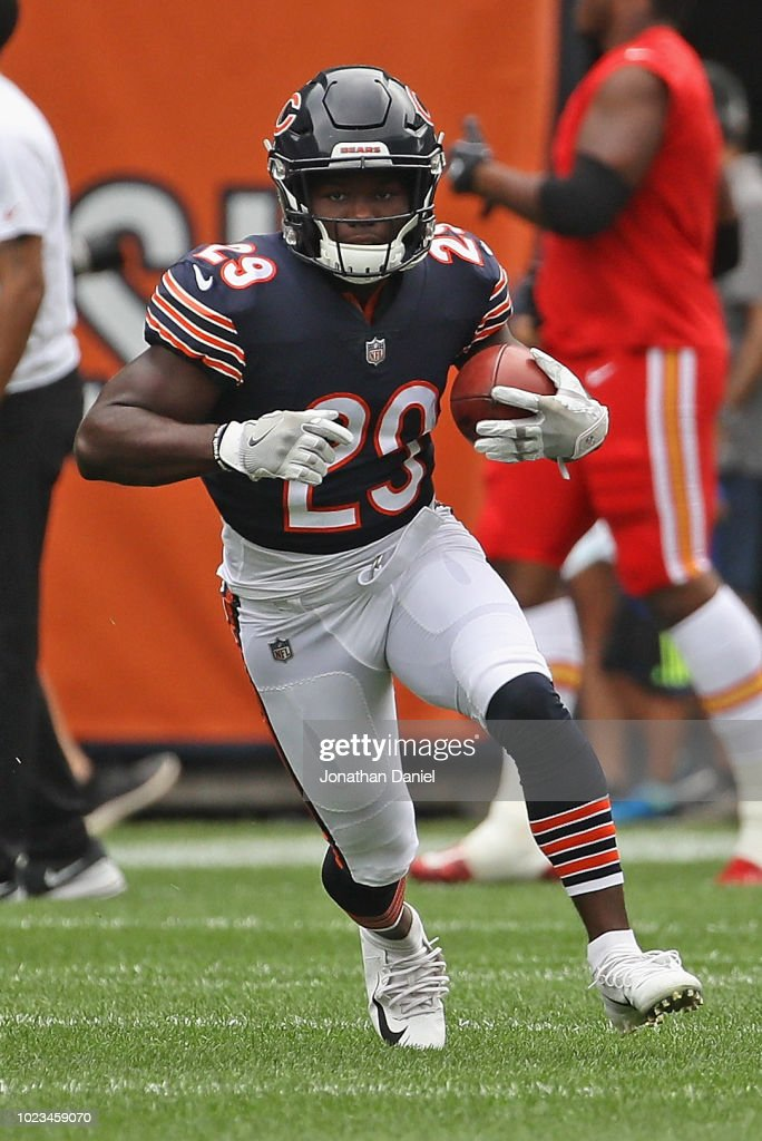 596fcea2d52 Tarik Cohen of the Chicago Bears participates in warm-ups before a ...