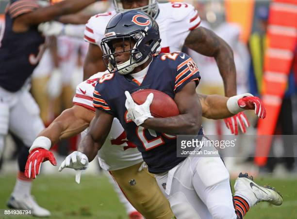 Tarik Cohen of the Chicago Bears returns a punt against the San Francisco 49ers at Soldier Field on December 3 2017 in Chicago Illinois The 49ers...