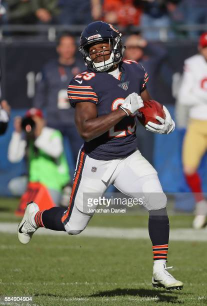 Tarik Cohen of the Chicago Bears returns a punt for a touchdown against the San Francisco 49ers at Soldier Field on December 3 2017 in Chicago...