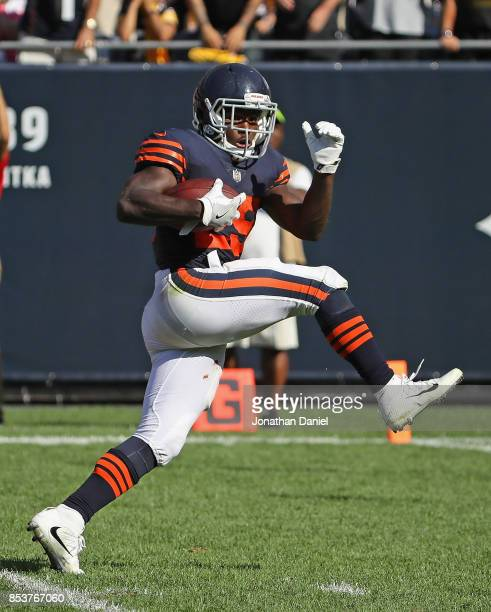Tarik Cohen of the Chicago Bears runs against the Pittsburgh Steelers on a long gain partially called back in overtime at Soldier Field on September...