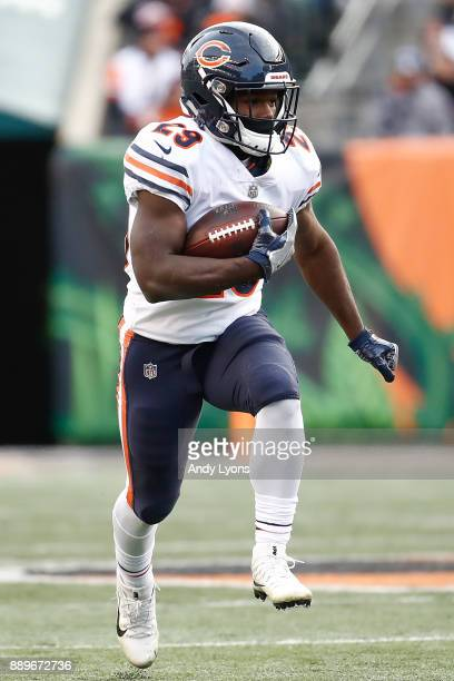 Tarik Cohen of the Chicago Bears runs with the ball against the Cincinnati Bengals during the second half at Paul Brown Stadium on December 10 2017...
