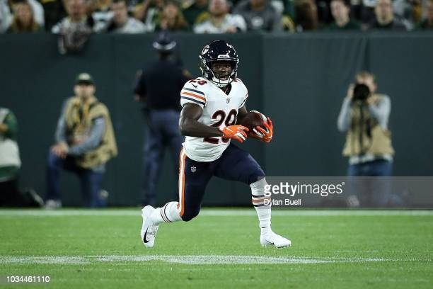 Tarik Cohen of the Chicago Bears runs with the ball in the first quarter against the Green Bay Packers at Lambeau Field on September 9 2018 in Green...