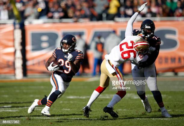 Tarik Cohen of the Chicago Bears runs with the football in the second quarter against the San Francisco 49ers at Soldier Field on December 3 2017 in...
