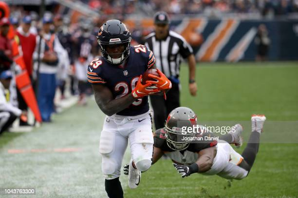 Tarik Cohen of the Chicago Bears runs with the football past Adarius Taylor of the Tampa Bay Buccaneers in the third quarter at Soldier Field on...
