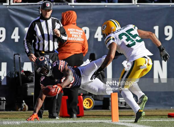 Tarik Cohen of the Chicago Bears scores a touchdown in the second quarter against the Green Bay Packers at Soldier Field on December 16 2018 in...