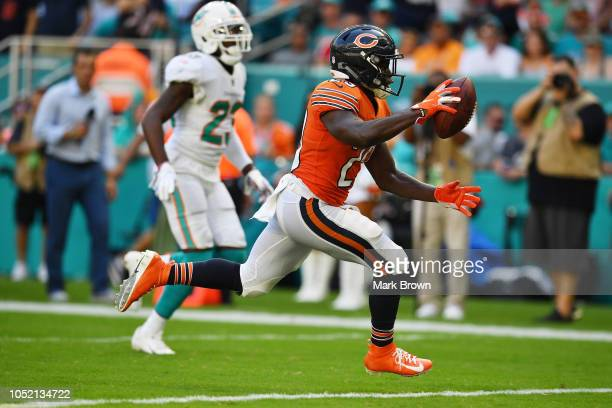 Tarik Cohen of the Chicago Bears scores a touchdown in the third quarter against the Miami Dolphins at Hard Rock Stadium on October 14 2018 in Miami...