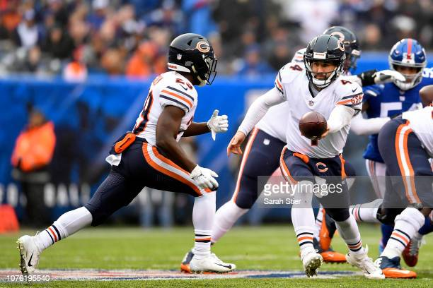 Tarik Cohen takes the handoff from Chase Daniel of the Chicago Bears during the first quarter against the New York Giants at MetLife Stadium on...