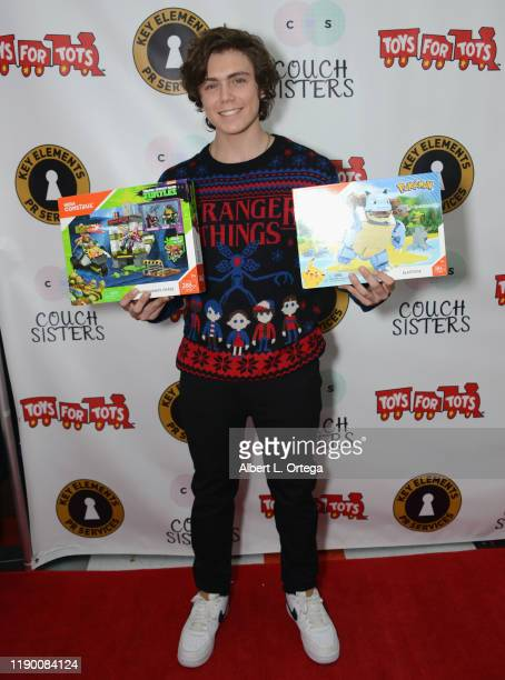 Tarik Ellinger attends The Couch Sisters 1st Annual Toys For Tots Toy Drive held onNovember 20 2019 in Glendale California