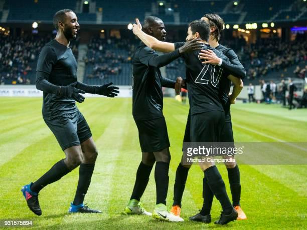 Tarik Elyounoussi of AIK celebrates scoring the opening goal with teammates Kristoffer Olsson Enoch Kofi Adu and Henok Goitom during a Swedish Cup...