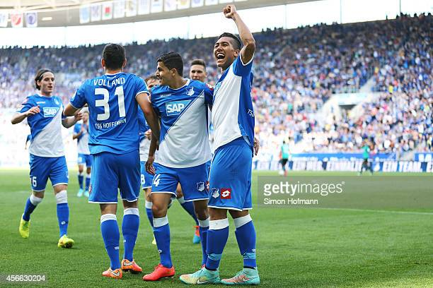Tarik Elyounoussi of Hoffenheim celebrates his team's first goal with his team mates Roberto Firmino and Kevin Volland during the Bundesliga match...