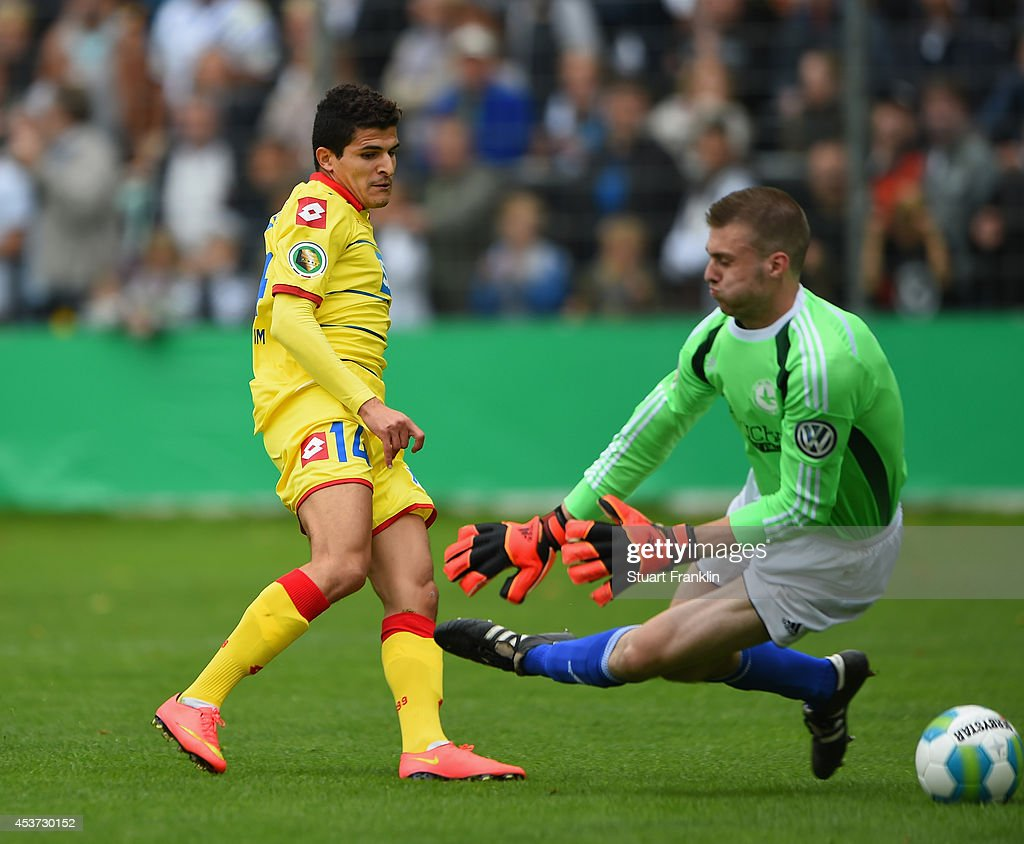 Tarik Elyounoussi of Hoffenheim scores the first goal past goalkeeper Yannik Jonas of Paloma during the DFB Pokal first round match between USC Paloma and 1899 Hoffenheim on August 17, 2014 in Hamburg, Germany.
