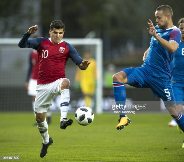 Tarik Elyounoussi of Norway Sverri Ingi Ingason of Iceland during International Friendly between Iceland v Norway at Laugardalsvollur National...