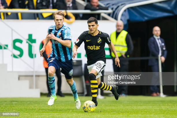 Tarik Elyounoussi runs with the ball during an Allsvenskan match between AIK and Djurgardens IF at Friends arena on April 15 2018 in Solna Sweden
