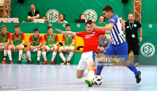Tarik Goezuesirin of Berlin challenges Yannick Heinzmann of Walldorf during the DFB Indoor Football match between FC Astoria Walldorf and Hertha BSC...