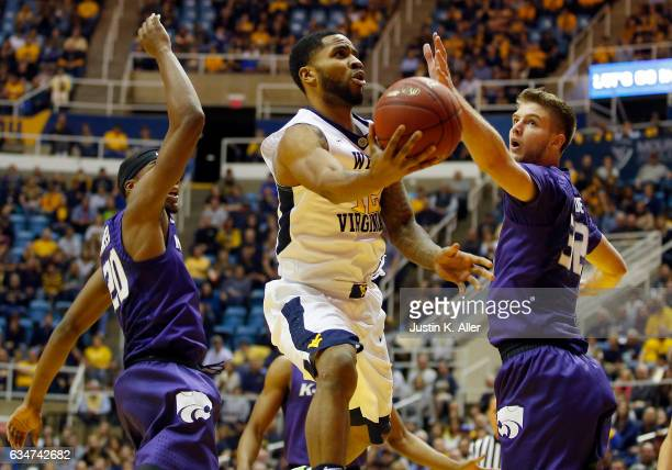Tarik Phillip of the West Virginia Mountaineers drives to the rim against Dean Wade of the Kansas State Wildcats at the WVU Coliseum on February 11...