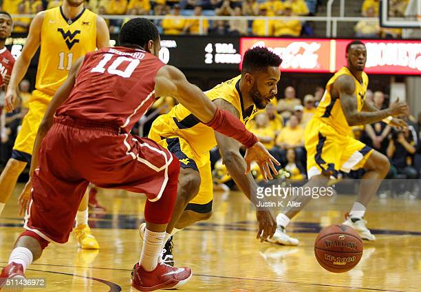 Tarik Phillip of the West Virginia Mountaineers steals the ball from Jordan Woodard of the Oklahoma Sooners during the game at the WVU Coliseum on...