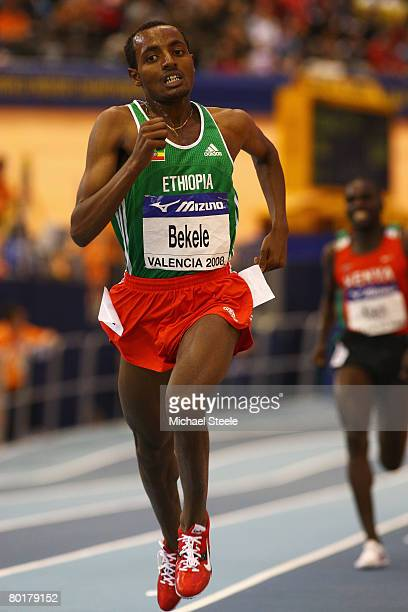 Tariku Bekele of Ethiopia crosses the line to win Gold in the Mens 3000 metre Final during the 12th IAAF World Indoor Championships at the Palau...