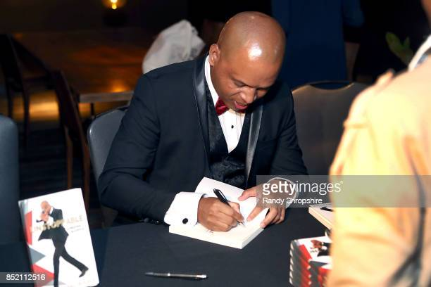 Tariku Bogale signs books during his launch of 'Unstoppable' on September 22 2017 in West Hollywood California