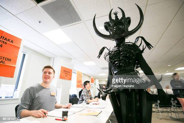 Tarikura Kapea dressed in World of WearableArt garment 'Cambrian Regeneration' by Ran Xu of China prepares to vote at Wellington City Library on...