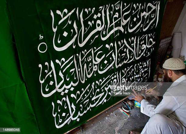 Tariq Ahmad a Kashmiri Muslim calligrapher writes Quranic verses on a banner for a Muslim customer during the first day of Ramadan on July 21 2012 in...