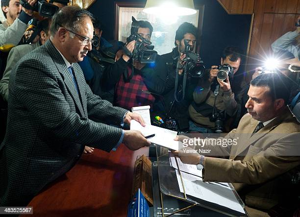 Tariq Ahmed Karra Kashmir's main opposition Peoples Democratic Party and a contesting candidate signs a nomination papers before handing over and...
