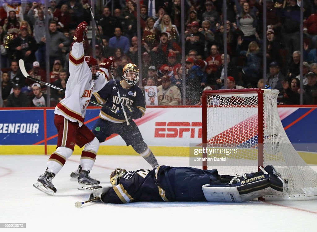 Tariq Hammond #3 of the Denver Pioneers celebrates scoring a second period goal against Cal Petersen #40 of the Notre Dame Fighting Irish during game two of the 2017 NCAA Division I Men's Hockey Championship Semifinal at the United Center on April 6, 2017 in Chicago, Illinois.