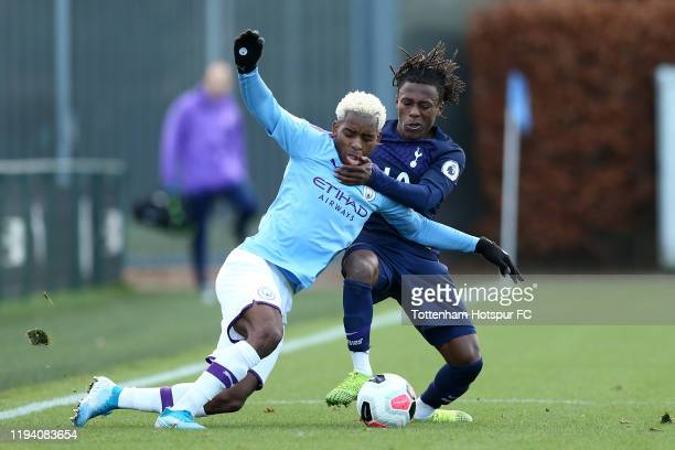 Tariq Hinds of Tottenham Hotspur battles with Jayden Braaf of Manchester City during the Premier League 2 match between Manchester City and Tottenham...