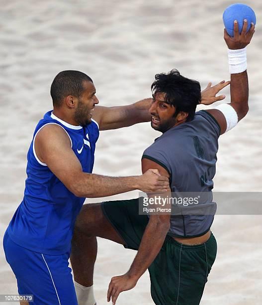 Tariq Iqbal of Pakistan shoots at goal the Men's Handball Final between Kuwait and Pakistan during the Beach Handball event at AlMusannah Sports City...