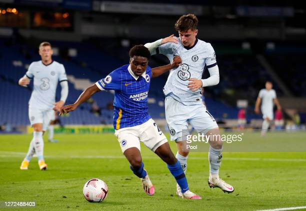 Tariq Lamptey of Brighton and Hove Albion battles for possession with Mason Mount of Chelsea during the Premier League match between Brighton & Hove...