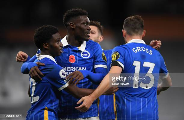 Tariq Lamptey of Brighton and Hove Albion celebrates with teammates Yves Bissouma and Pascal Gross after scoring his sides first goal during the...
