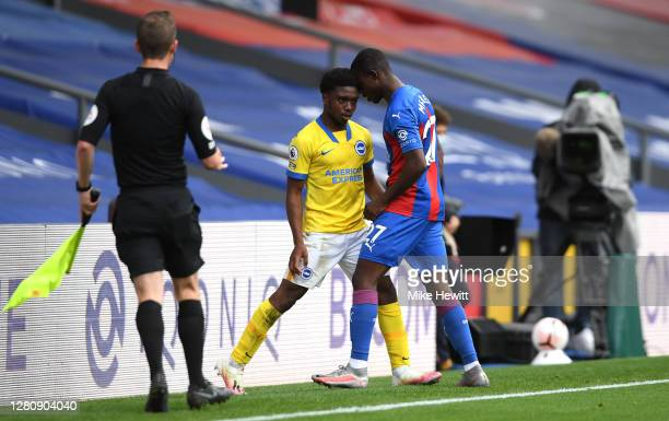 Tariq Lamptey of Brighton and Hove Albion clashes with Tyrick Mitchell of Crystal Palace during the Premier League match between Crystal Palace and...