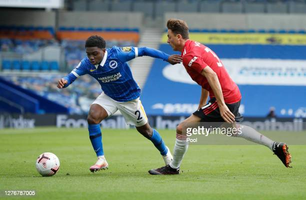 Tariq Lamptey of Brighton and Hove Albion is challenged by Nemanja Matic of Manchester United during the Premier League match between Brighton & Hove...