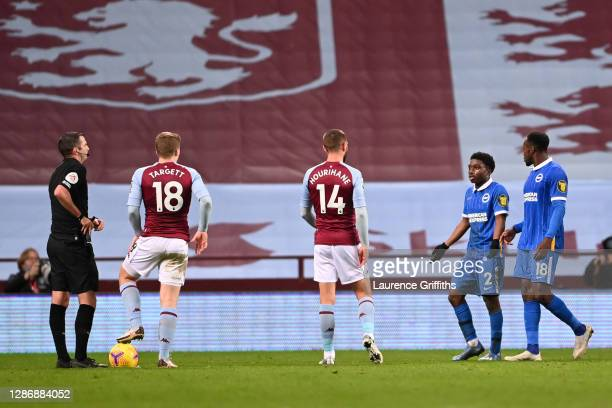 Tariq Lamptey of Brighton and Hove Albion reacts as referee Michael Oliver awards him a red card during the Premier League match between Aston Villa...