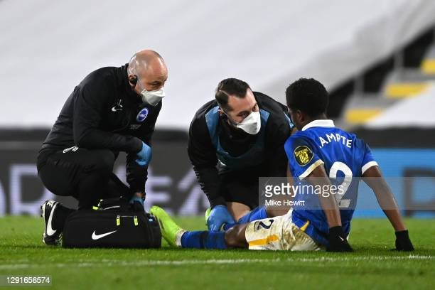 Tariq Lamptey of Brighton and Hove Albion receives medical treatment during the Premier League match between Fulham and Brighton & Hove Albion at...