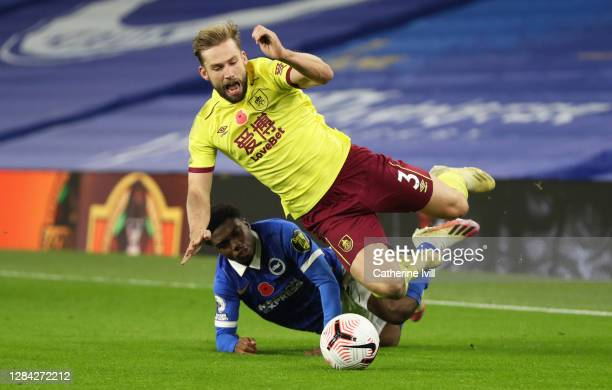 Tariq Lamptey of Brighton and Hove Albion tackles Charlie Taylor of Burnley during the Premier League match between Brighton & Hove Albion and...