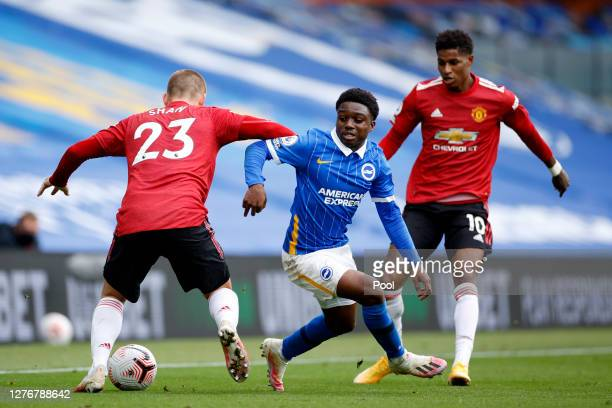 Tariq Lamptey of Brighton and Hove Albion takes on Luke Shaw of Manchester United during the Premier League match between Brighton & Hove Albion and...