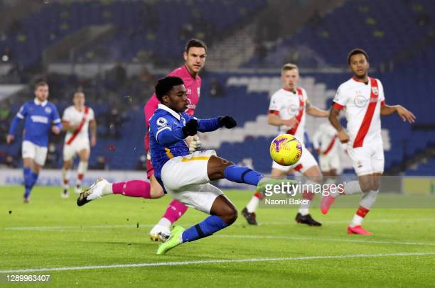 Tariq Lamptey of Brighton & Hove Albion attempts to take the ball around Alex McCarthy of Southampton during the Premier League match between...