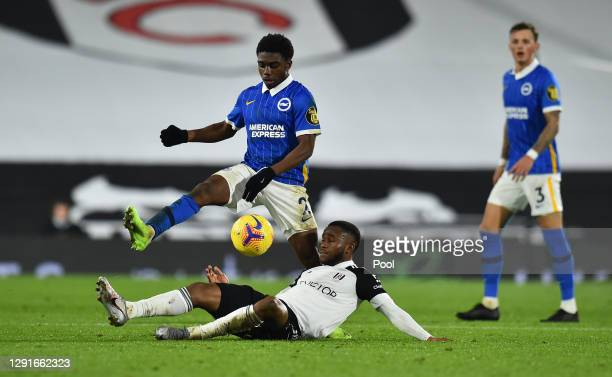 Tariq Lamptey of Brighton & Hove Albion battles for possession with Ademola Lookman of Fulham during the Premier League match between Fulham and...