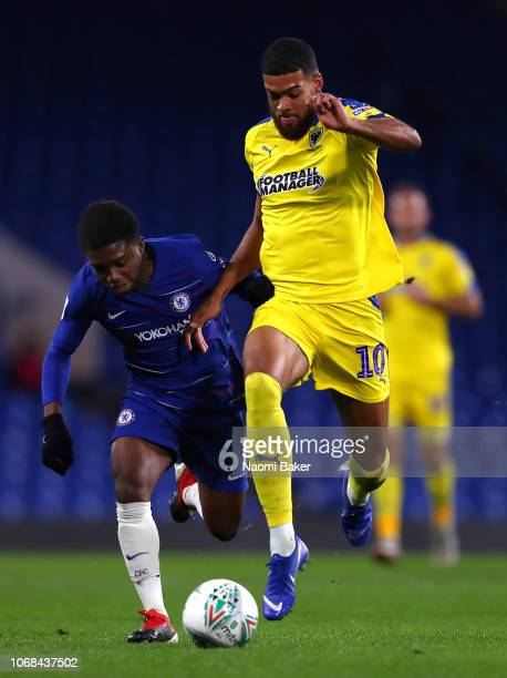 Tariq Lamptey of Chelsea battles for posession with Jake Jervis of AFC Wimbledon during the Checkatrade Trophy second round match between Chelsea U21...