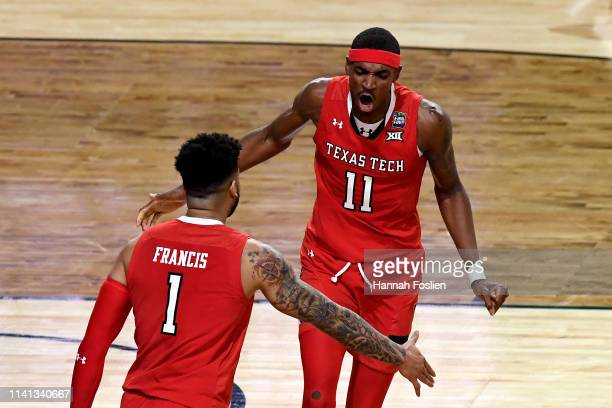 Tariq Owens and Brandone Francis of the Texas Tech Red Raiders reacts against the Virginia Cavaliers in the first half during the 2019 NCAA men's...