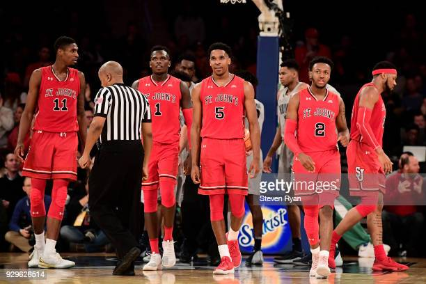 Tariq Owens Bashir Ahmed Justin Simon and Shamorie Ponds of the St John's Red Storm celebrate a lead over the Georgetown Hoyas during the first round...