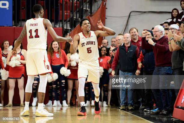 Tariq Owens congratulates Justin Simon of the St John's Red Storm after their team secures the lead late in the overtime period against the Butler...
